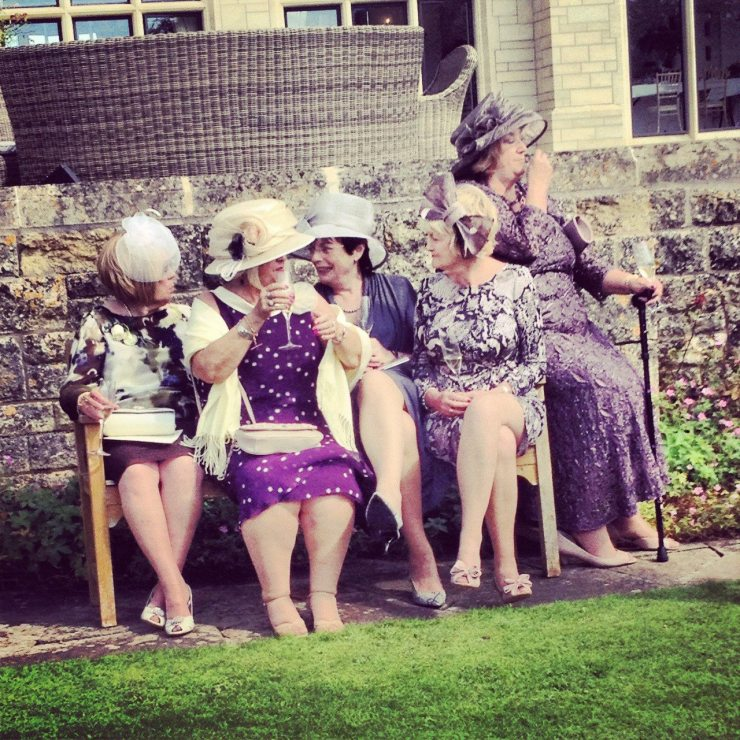 british ladies in hats at a wedding